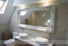 french style bathroom mirror on pale travertine marble
