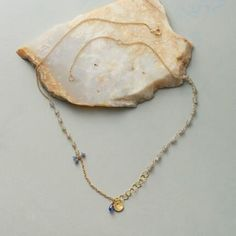 """RAINDROPS & BLUEBELLS NECKLACE Modern, low-key and really lovely, Anne Sportun's wear-with-anything necklace is a fresh mix of labradorite rondelles in pairs and singly, blue sapphire drops, a teardrop of bright blue kyanite and a hand wrought charm of matte 14kt gold, all on small and large polished links of 14kt gold. Spring ring clasp. Handcrafted in Canada. Exclusive. 16"""" to 18""""L. Internet Exclusive."""