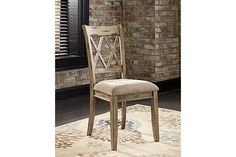 "The Mestler Upholstered Side Chair from Ashley Furniture HomeStore (AFHS.com). With the variety of finishes beautifully adorning the rich rustic design of each piece, the ""Mestler"" dining collection takes Vintage Casual and offers an array of furniture to suit the needs of any dining room décor."