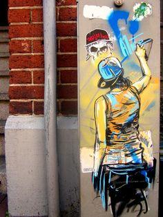 een meisje dat aan het graffiti is maar zij staat er zelf op, ziek