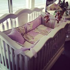 """Cleopatra Crib in White by Romina Furniture, with """"Viola Collection"""" bedding by Glenna Jean."""