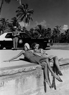 Jerry Hall and model Lisa Taylor survey the scene. Photographed by Helmut Newton, Vogue, January 1975.