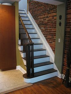 painted stairs with wood banister Wood Stairs, Basement Stairs, House Stairs, Basement Ideas, Black Painted Stairs, White Stairs, Faux Brick Panels, Brick Paneling, Staircase Makeover