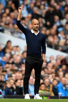 Josep Guardiola Photos - Josep Guardiola, Manager of Manchester City gives his team instructions during the Premier League match between Manchester City and Liverpool at Etihad Stadium on September 9, 2017 in Manchester, England. - Manchester City v Liverpool - Premier League