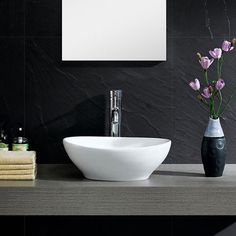 Bring added elegance to your bathroom with this Fine Fixtures modern vessel sink.  Constructed of durable and stain resistant vitreous china this oval sink features sleek sides and its rounded appearance provides it with a modern and fresh look.