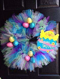 Easy & Inexpensive Easter / Spring Wreath. Made with A Wire Coat Hanger, Tule, and Decor from the Dollar Tree.
