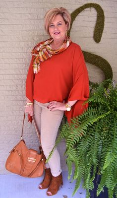 The poncho is a huge trend this Fall. A series of outfits, featuring ponchos, can be found 50isnotold.com. See how I style this years big trend.