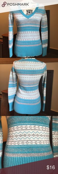 Wool-Blend Fairisle Sweater Super cute, teal wool-blend sweater with fairisle design (color looks more blue in the photos). Would be really cute with a pair of jeans and a cream, teal, or gray puffer vest. Comes from a smoke free home. Old Navy Tops
