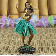 This dancing hula girl tricks out your ride in retro tiki style. Made of poly resin, this wahine doll features a colorful grass skirt and hip-swinging action. A sweet dashboard ornament that's perfect for desks or classic cars. Adds Hawaiian heat to your cubicle decor. Measures 2