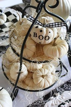 "Without the ""Boo"" on it.  I like the tiered centerpiece piled with mini pumpkins"