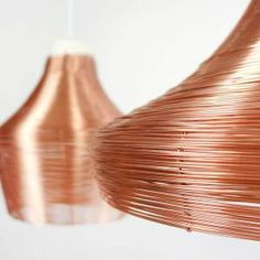 A pendant lamp which is braided from one single piece of copper wire. The proven technique of baskets weaving is implemented for modern use as braiding copper. Copper wire is securely woven by hand and results in a great see-through effect. When the light is on, a warm color reflection of the copper will fill the room. The lamps contain …