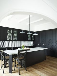 black kitchen.  diamond pantry doors  Greg Natale | Sydney based architects and interior designers