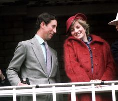 Diana At Aintree: The Prince and Princess of Wales at the Aintree racecourse for the Grand National, April 1982. She wears a red mohair maternity coat. (Photo by Jayne Fincher/Princess Diana Archive/Getty Images)