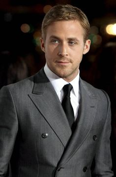 Mr. Gosling in grey double breasted tailore suit, black tie and white custom tailored dress shirt.
