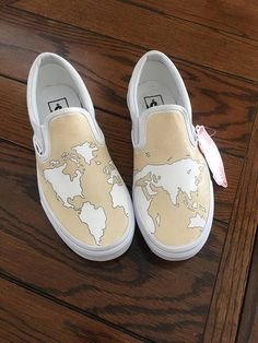These hand-painted shoes are made to order for each customer. I buy standard white slip-on Vans from the Vans retailer and paint them. I use a fabric paint and seal it with a fabric sealer. Other color combinations available upon request. Please specify which shoe size at check out