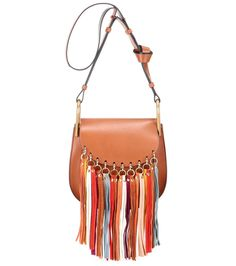 Chloé - Mini Hudson leather shoulder bag - Chloé's 'Mini Hudson' shoulder bag is a romantic, bohemian dream. In a conveniently compact design, it comes crafted in Italy from smooth calf leather in a sumptuous caramel hue. Oversized suede tassels in a rainbow of bold colours provide retro character, while the knotted shoulder strap gives it a casual finish. seen @ www.mytheresa.com