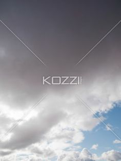 blue sky with dark clouds - Image of blue sky with dark clouds