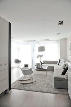 Design salotto scandinavo, elegante e moderno, con arredi, mobili e pareti grigio tortora