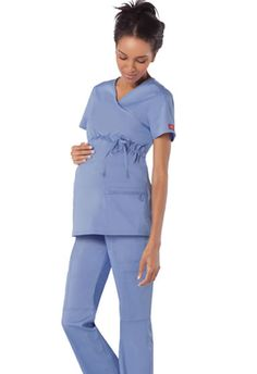 Dickies Maternity Mock Wrap #85900 NationalScrubs.com Embrace your beauty! Enjoy premium comfort and chic styling in these Dickies maternity scrubs. Designed for all nurses and medical professionals, this mock wrap top features, multi-sectional patch pockets, utility loops, side vents, and a front adjustable drawstring to flatter your beautiful baby bump.