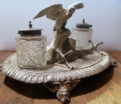 This is an antique ink well and stand. Very cool!