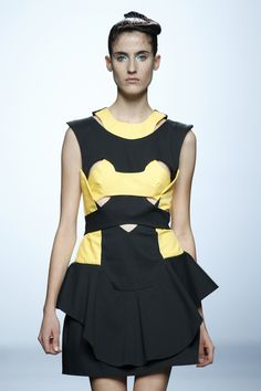 Cotton cut-out black and yellow dress. Olympia SS15 show.