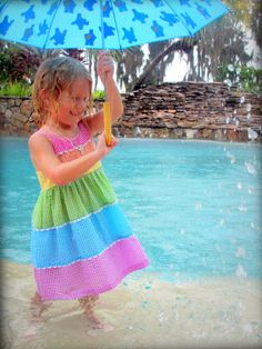 """Tropical Storm Debby had us pinned up in the house all day, so I took the kids outside for a fun pretend """"photo shoot""""... ate up about 2 hours and they had a blast... and I got some great pictures!  Here is Cece loving it. Win/Win for all!"""
