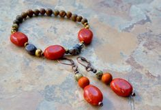 Earrings and a bracelet! Carnelian stones are powerful and worn for wholeness and self esteem. Earrings are 2 inches long and Stretch bracelet is 7 inches. Enjoy this beautiful set in any season. Orange is the color of creativity , follow your bliss with these beautiful earrings. $35.00 USD Namaste, Temeka