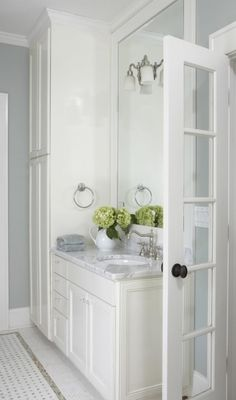 bathroom white with carrera marble counter top and basket weave pattern white and grey floor tiles