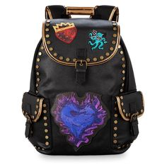 The Descendants kids have got your back with this faux leather fashion backpack detailed with menacing metal studs, gold trim, and embroidered appliques. The dragons logo adds a mischeivous accent to this roomy bag, which features handy side pockets. Disney Descendants Dolls, Disney Descendants 3, Descendants Costumes, Descendants Cast, Carlos Descendants, Fashion Bags, Fashion Backpack, Personalized Backpack, Zeina