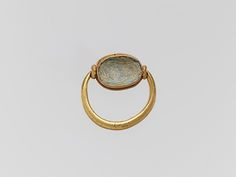 Gold ring with glass paste ring stone, 6th -5th B.C, Greek