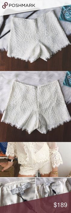 •Alexis Ivory White Gigi Lace Hi-Waisted Shorts• Alexis white ivory Gigi lace shorts. These high-waisted super trendy shorts are perfect for a girls night out. Zip back with eye hook closure. Lace detail and hem. 66% polyester, 18.5% nylon, 14.6% cotton, & 0.9% rayon. Logo tag is coming unstitched on one side.   •color: white ivory  •size: medium  •New with tags (comes in original packaging).   Approx Measurements laying flat:     •waist: 14.5in  •No trades(comments will politely be…
