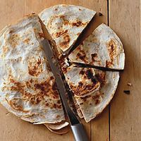 Sweet-Potato Chicken Quesadillas, these are sooo delicious.  I use the whole grain low carb tortilla's.  Ingredients are simple- boiled sweet potato, can black beans, shredded chicken and cheese. I use mozerella.  Enjoy!!