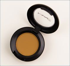 """MAC Eyeshadow in """"Outre"""" - It's a mustard yellow shadow that's beautiful for autumn looks. I can't get over how much I love it."""