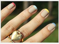 Awesome nude & rainbow manicure.