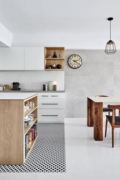 Demarcate your open-concept kitchen with colourful or patterned tiles.