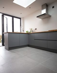 Beautifully understated Smoked Grey Cemento Concrete Effect Porcelain Tiles. Cement and concrete effect porcelain tiles in a range of sizes and colours. Concrete Look Tile, Stone Tile Flooring, Concrete Kitchen, Grey Flooring, Kitchen Tiles, Kitchen Flooring, Grey Kitchen Floor, Modern Grey Kitchen, Grey Floor Tiles