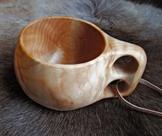 Wooden cup on rope