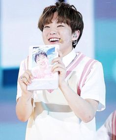 They were carrying wonwoos photo bc he couldnt come < AW THATS SO CUTE