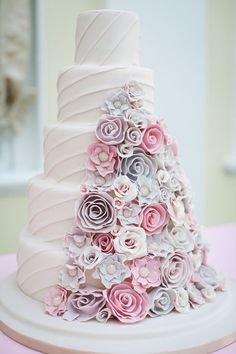 I love the flowers down the side!!!!!!!!!!! I like the layers!!!!!!!!!!!!!!! This is my kind of Wedding cake!!!!!!!!!!!!!!!
