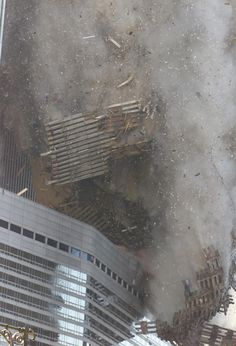 Debris rains down on the street as the South Tower of the World Trade Center collapses after hijacked planes crashed into the towers on September 11, 2001 in New York City.