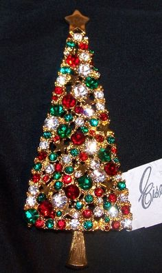 EISENBERG ICE Christmas Tree Pin covered with rhinestones and gold stars