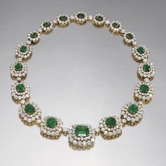 M. GERARD. Emerald and diamond necklace, M. Gérard. Composed of a graduated line of step-cut emeralds, each within a double border of brilliant-cut diamonds, alternating with a single brilliant-cut diamond, the back set with similar stones, mounted in yellow gold, signed M. Gerard and numbered, French assay and maker's marks, fitted case. length 420mm, detaches to form one bracelet measuring 165mm. #HighJewelry #HauteJoaillerie #Diamond #Emerald