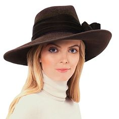 """Dramatic fedora of fur felt velour is sashed and bowed with rich sumptuous velvet. Brim can be worn in a profile position or down all around. Fully lined, elasticized inner band fits most. Famous Words of Inspiration...""""The last temptation is the greatest treason: to..."""