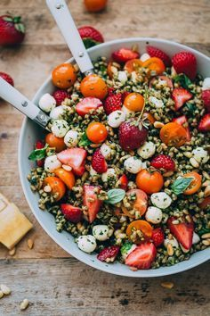 GIRLBOSS EATS: Quick summer meals // Strawberry Caprese Farro Salad Recipe --Farro:1 cup farro, rinsedBasil Pesto:1 small peeled garlic clove2 and 1/2 ounces fresh basil leaves (one overflowing packed cup)1/4 cup toasted pine nuts1/3 cup extra virgin olive oil2 tablespoons finely grated parmigiana-reggiano cheesekosher saltfreshly ground black pepper