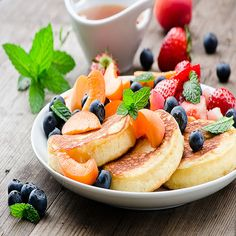 Topping your pancakes with fruit makes for a more filling and delicious breakfast! #Breakfast #Pancakes #Fruit
