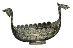 a large norwegian silver-gilt an ||| navette ||| sotheby A large Norwegian silver-gilt and plique-à-jour enamel boat, Marius Hammer, Bergen, circa 1900 in the form of a 'Dragestil' Viking boat, decorated with bands of ornament, flowers and leaves in many colours