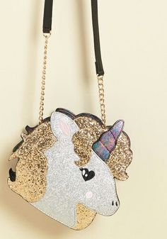 It is our delight to introduce you to this sparkling unicorn purse! All gussied up with gold and silver glitter, and finished with a midnight marbled back to match its horn, this accessory from Betsey Johnson will make Real Unicorn, Unicorn Gifts, Magical Unicorn, Cute Unicorn, Rainbow Unicorn, Rainbow Bag, Unicorn Fashion, Unicorn Rooms, Unicorns And Mermaids
