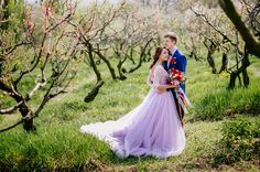 A sea of white blossoms on an unseasonably warm day; a lavender ball gown topped with a crown of fresh flowers; a sweet couple vowing to love one another, all because the groom took a risk to get the girl…sounds like a fairy tale to us! When their mutual friend showed him a photo of Ann...