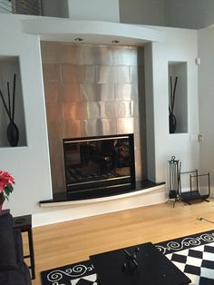 Custom Design Project | 12x24 Stainless Steel Subway Tile Frames Fire Place | Modern Focal Point | More Ideas at www.StainlessSteelTile.com | Customer Photo