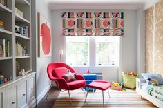 Contemporary Traditional Bookshelf: A red womb chair and a striped rug in a child's bedroom.